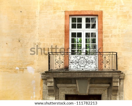 Old building with a balcony in the French town