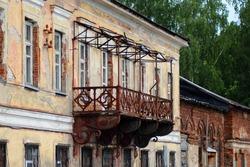 Old building with a broken balcony,retro