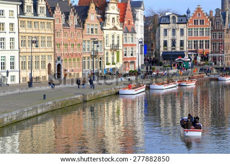 Old buildings along sunny riverside in Ghent, Belgium #277882850