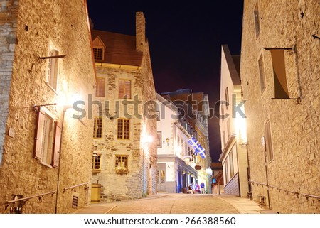 Old buildings on street at night in Quebec City #266388560