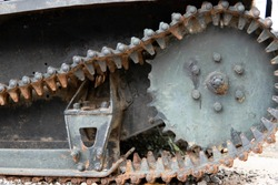 Old Bulldozer tracks and drive gear with sprocket construction machine, heavy industry