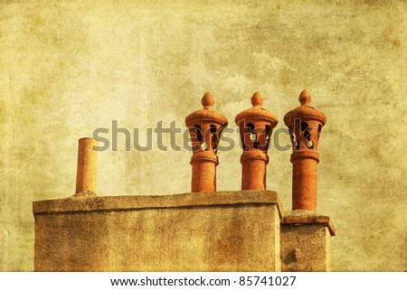 old burnt chimney pots on a decorative grunge background