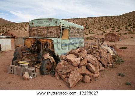 Old bus in an altiplano village near San Pedro de Atacama, north Chile
