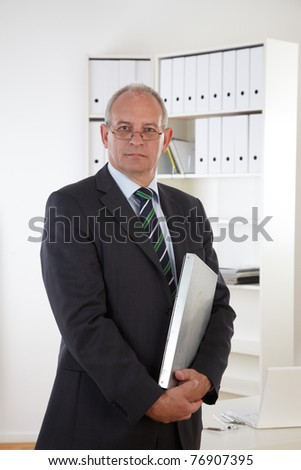 Old business man with clipboard - stock photo