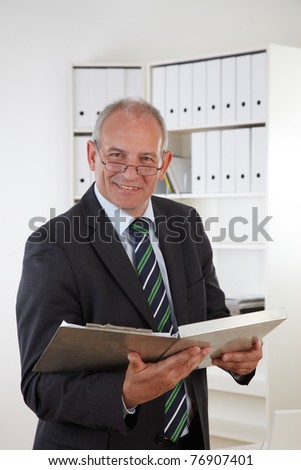 Old business man with clipboard