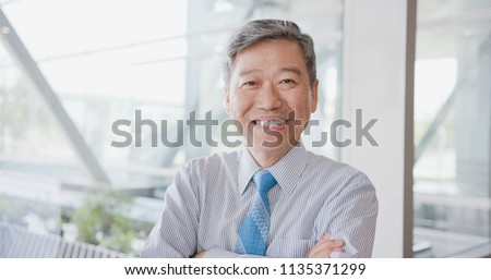 old businessman look you and smile happily