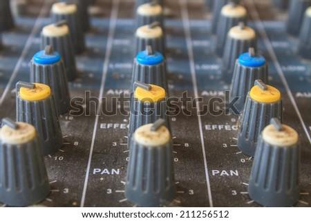 old buttons equipment in audio recording studio