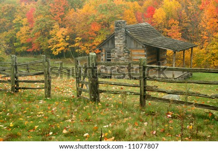 Old cabin and fence during fall of the year.