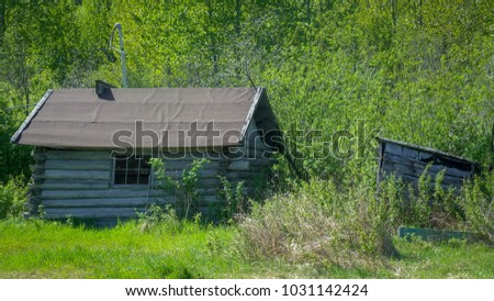 old cabins in the middle of the ...