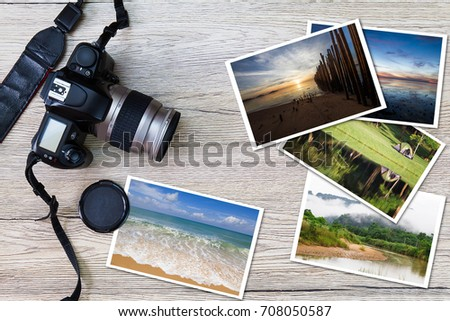 Old camera and stack of photos on vintage grunge wooden background, photography hobby lifestyle concept