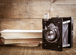Old camera and stack of vintage books