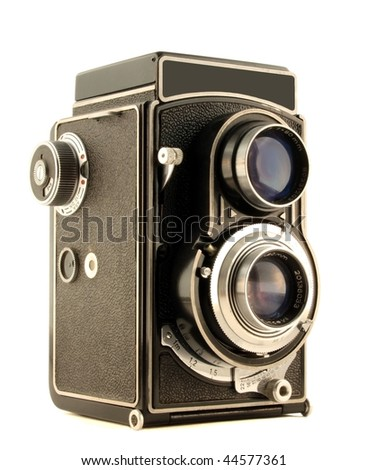 Old camera isolated on pure white