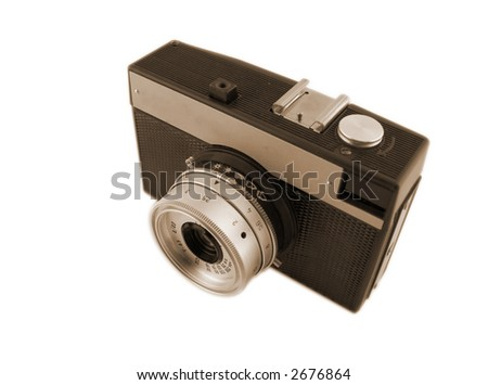 Old camera isolated on white background. Shallow depth of field. Sepia toning.