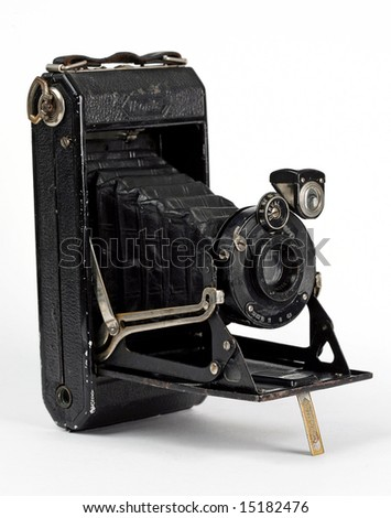 Old camera on wight background.