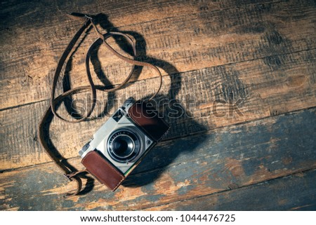 old camera on wooden background....