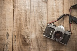 old camera on wooden floor vintage style