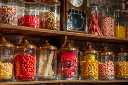 Old candy store. Colorful candies in jars. Old fashioned retro style