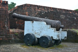 Old cannon ball defense for war artillery display during Spanish era in Philippines