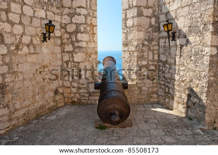 Old cannon in ancient fortress on seaside. Hvar island town, Croatia