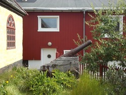 old cannon in the garden of a historic building in Qaqortog, Iceland