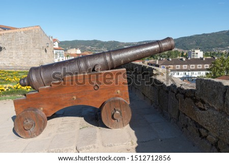 Old cannon on the castle wall of Chaves. Portugal. #1512712856