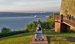 Old cannon pointing to St Lawrence river