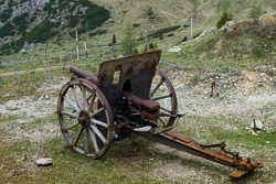 Old cannon with wheels in the mauntains
