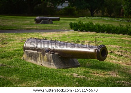 Old cannons now residing in an urban park. #1531196678