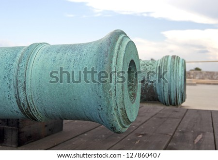 Old canons aiming at the sea, on an overcast day. Old Castillo de San Marcos, St. Augustine, Florida