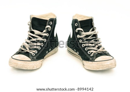 Old canvas sneakers, isolated