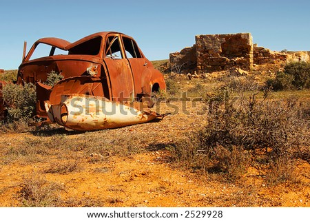 old car and ruins in the outback