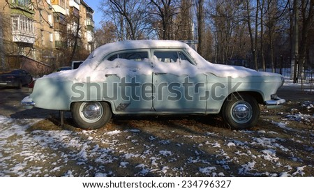 Old car covered with snow - Old soviet car - Vintage auto