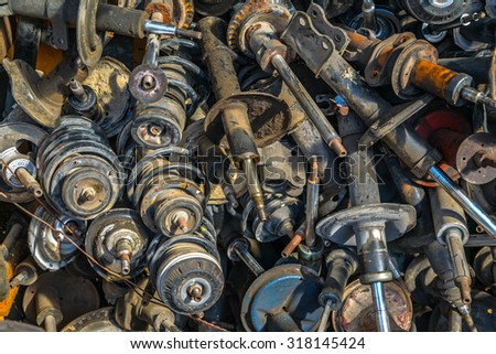 Old car dampers pell-mell piled #318145424