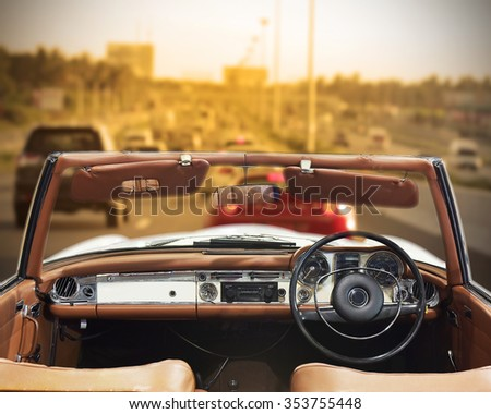 old car driving on the road at...