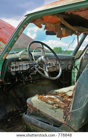 Old Car in Disarray Rusted and Torn