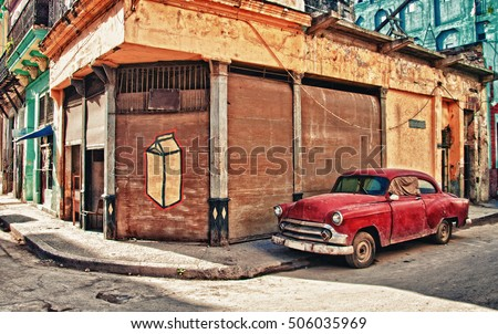 old car parked on the street of habana #506035969
