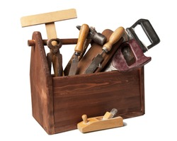 Old Carpenter Wooden toolbox with tools isolated on white.
