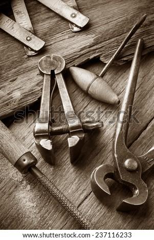 old carpenter workshop with vintage tools,sepia image