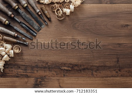 Old carpentry tools on a workbench and blank copyspace: woodworking, craftsmanship and handwork concept, flat lay
