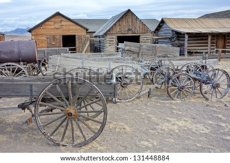 Old carts in a Ghost town near Cody, Wyoming, United States