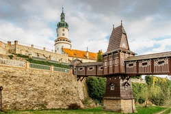 Old carved wooden Jurkovic bridge with charming castle tower in Nove Mesto nad Metuji, pearl of Eastern Bohemia, Czech Republic.Czech renaissance chateau. Popular tourist destination.Fairy tale castle