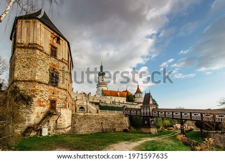 Old carved wooden Jurkovic bridge with charming castle tower in Nove Mesto nad Metuji, pearl of Eastern Bohemia, Czech Republic.Czech renaissance chateau. Popular tourist destination.Fairy tale castle Stock photo ©