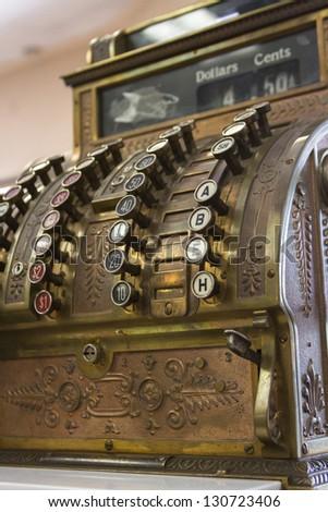 Old cash register close-up. #130723406
