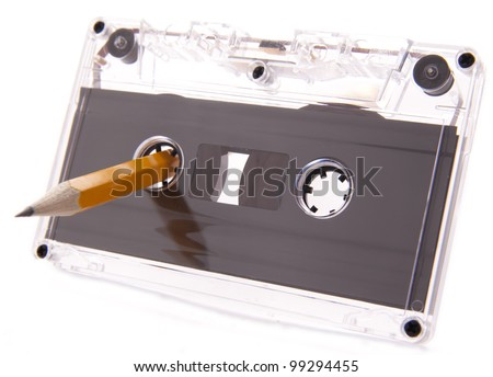 Old cassette tape isolated over a white background with pencil for rewind - stock photo