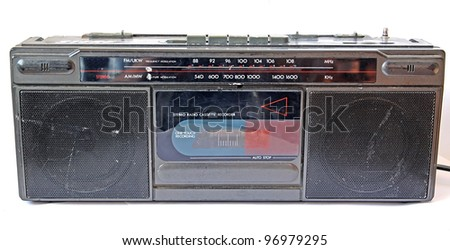 old cassette tape-recorder on white background
