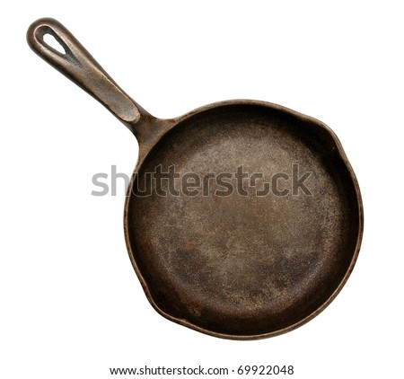 old cast iron frying pan, isolated on white