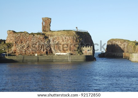 old castle and harbour entrance at Dunbar, East Lothian, Scotland in winter sunlight