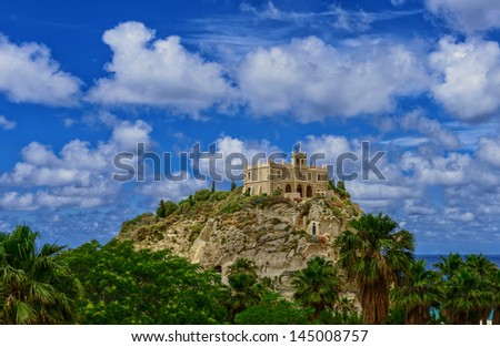 old castle in the Italian town of Tropea on a background of sea and sky