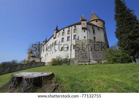 Old castle of Oron by beautiful weather, Oron-le-Chatel, Vaud canton, Switzerland, next to a cut trunk