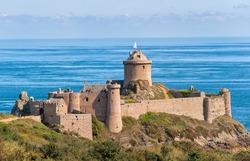 Old castle on Cote de Granit Rose coast of English Channel, Fort La Latte, Brittany, France